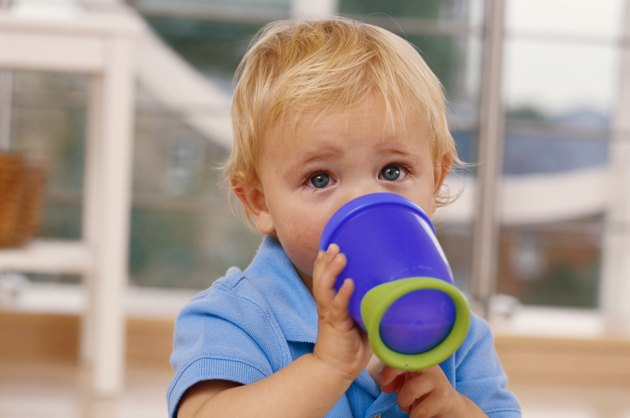 Baby boy (12-15 months) drinking from mug, close-up