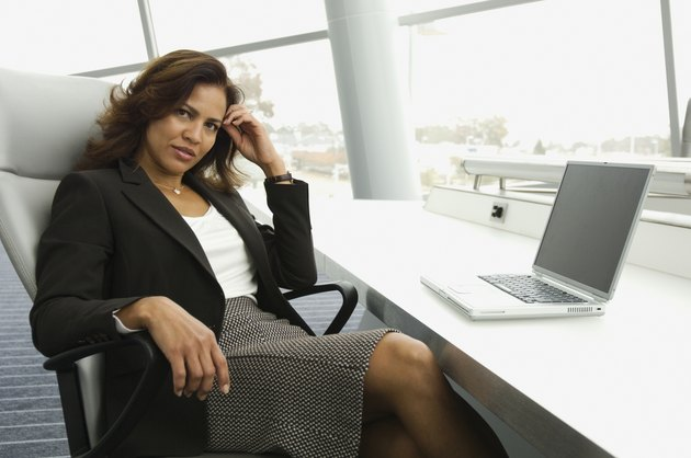 Hispanic businesswoman next to laptop