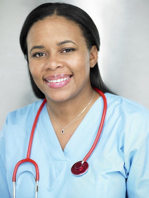 Female doctor smiling, portrait