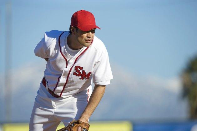 USA, California, San Bernardino, baseball pitcher preparing to throw, outdoors