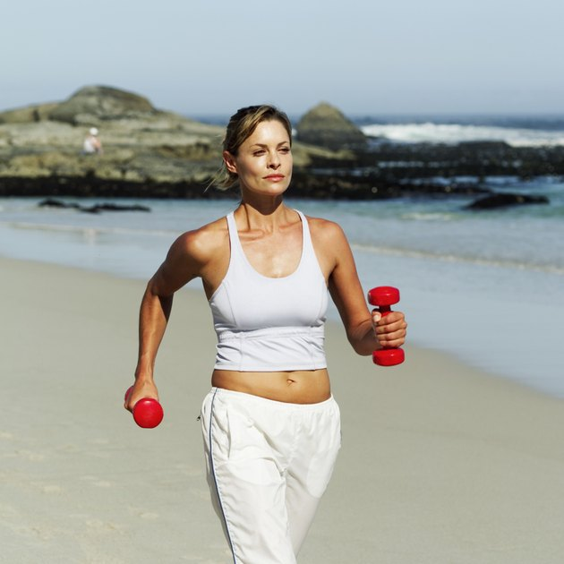 woman exercising at the beach