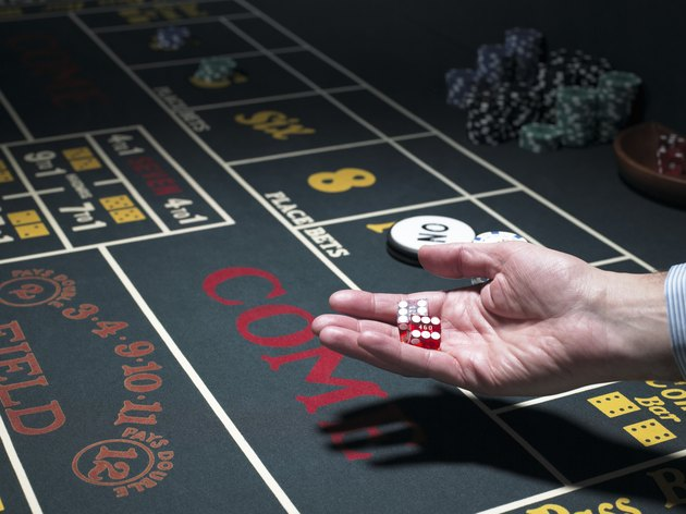 Man holding dice at craps table, close-up
