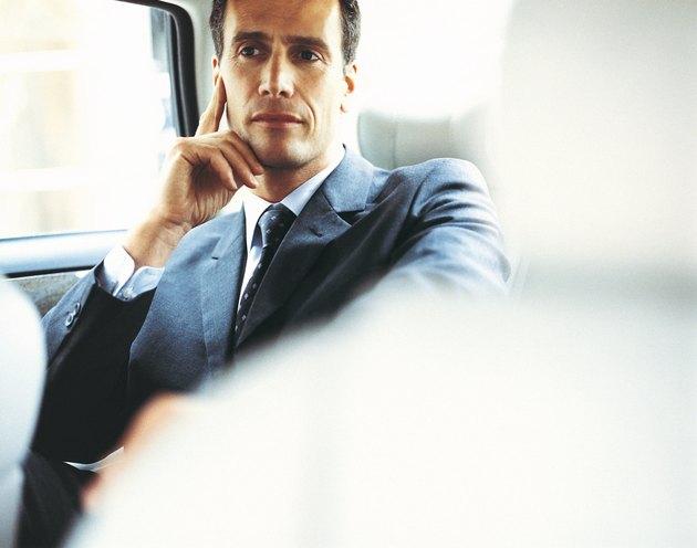 Pensive Businessman in a Car