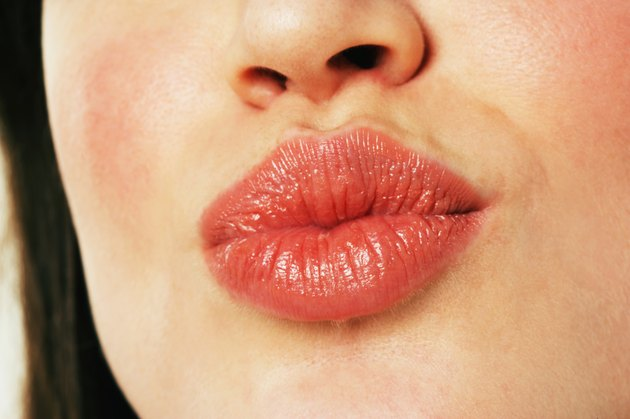 Young woman puckering lips, close-up