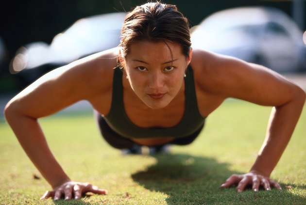 portrait of a young woman doing push ups