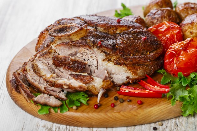 roasted pork shoulder on the bone with potatoes