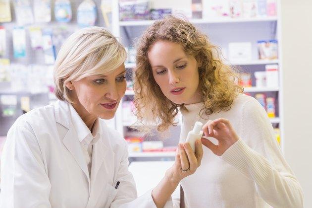 Pharmacist explaining something to a customer