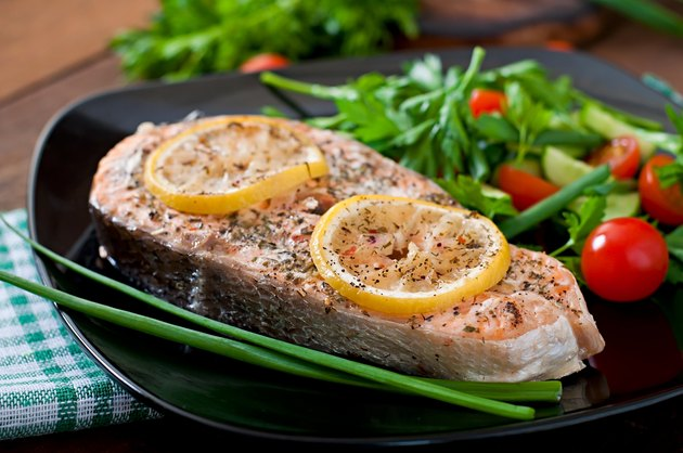 Baked salmon steak with lemon and herbs