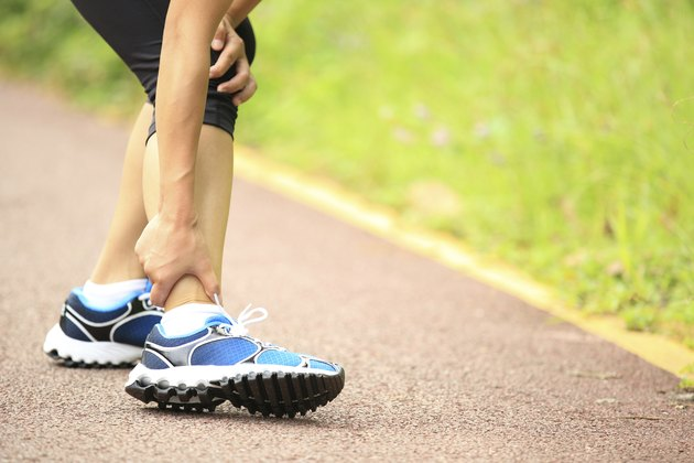woman runner hold twisted ankle