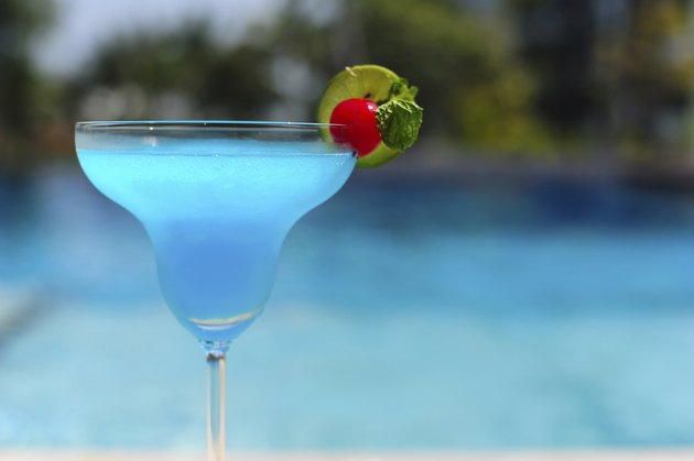 Blue cocktail on swimming pool side