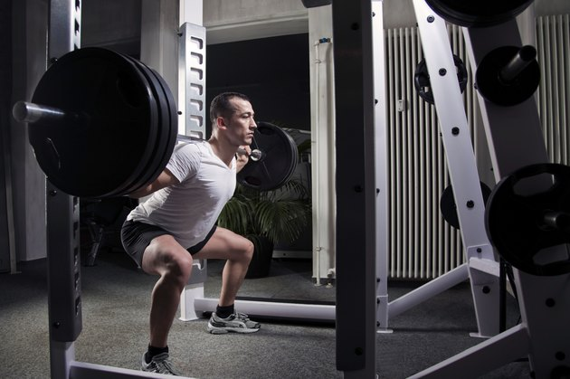 squatting heavy weights in squat rack