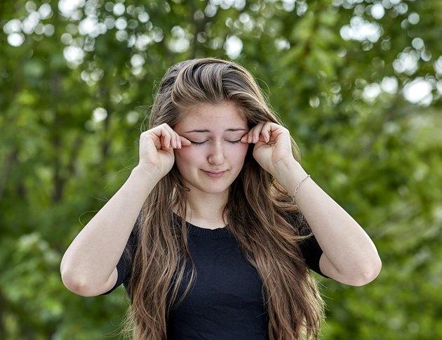 Sleepy Woman rubbing her Eyes