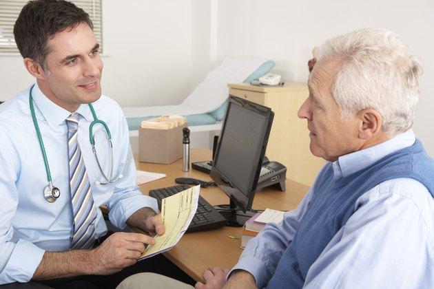 British GP talking to senior man in surgery