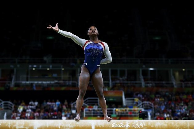 RIO DE JANEIRO, BRAZIL - AUGUST 11: Simone Biles of the United States competes on the balance beam during the Women's Individual All Around Final on Day 6 of the 2016 Rio Olympics at Rio Olympic Arena on August 11, 2016, in Rio de Janeiro, Brazil. (Photo by Elsa/Getty Images)