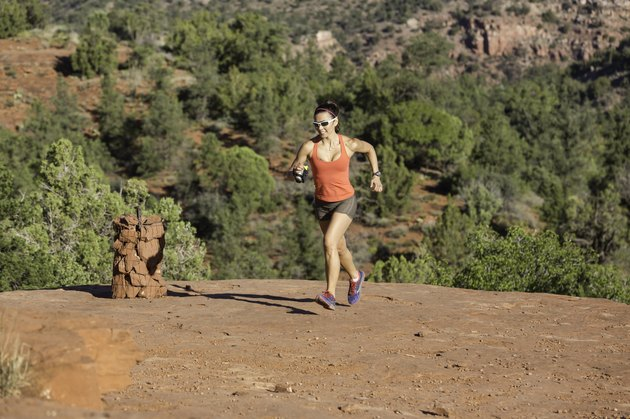 Woman Trail Running Uphills