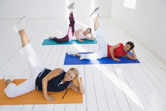 Women lifting legs on yoga mats
