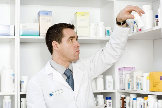 Pharmacist with pill bottle