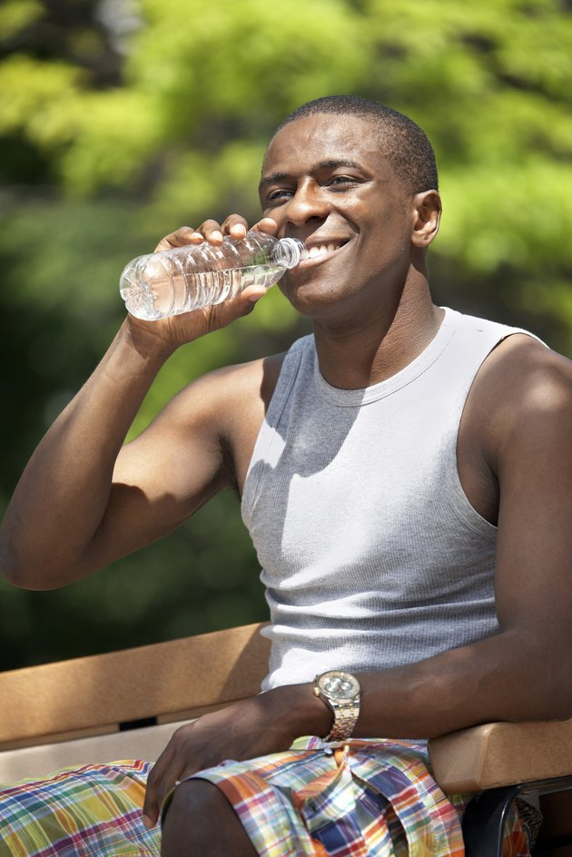 Close-up of a young man drinking water