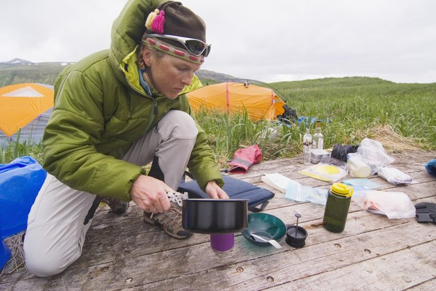 Man cooking at campsite