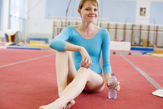 Young gymnast with bottled water