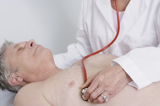 Senior medical practitioner examines man with stethoscope