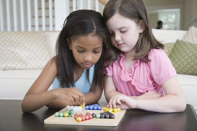 Close-up of a two girls playing a board game