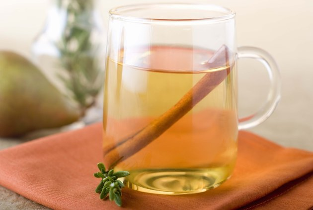 Apple cider with cinnamon stick in glass mug
