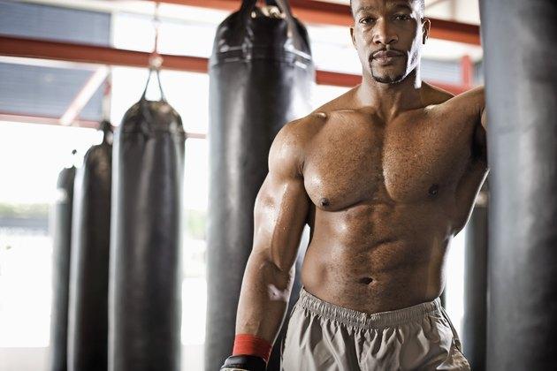 Man standing next to punching bag