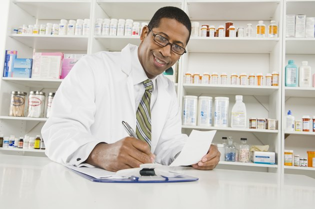 Male pharmactist working in pharmacy