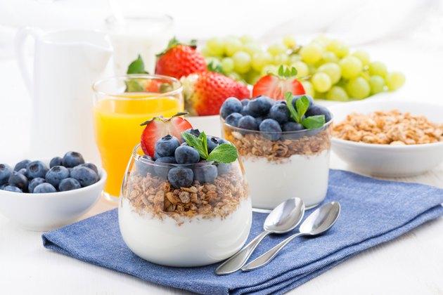 delicious dessert with cream, fresh berries and muesli