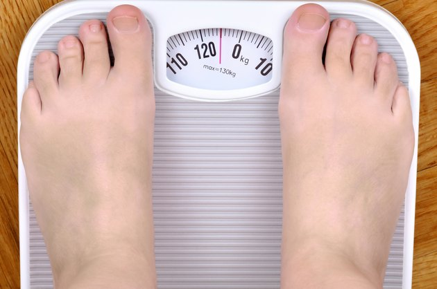 Barefoot person on the scale