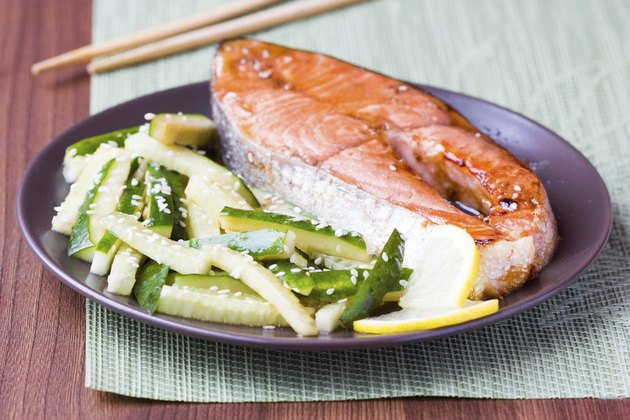 Red fish grilled salmon with cucumber salad, soy sauce, Japan
