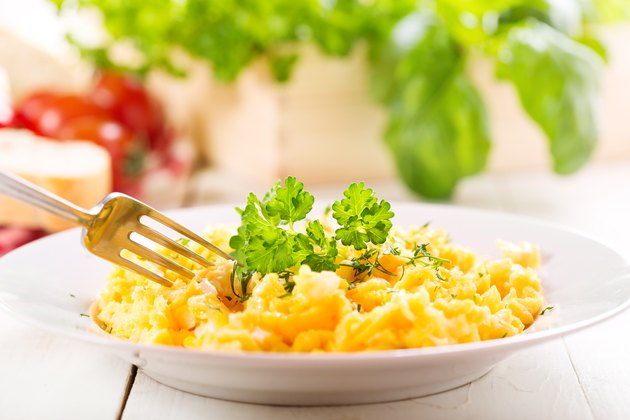 plate of scrambled eggs with parsley