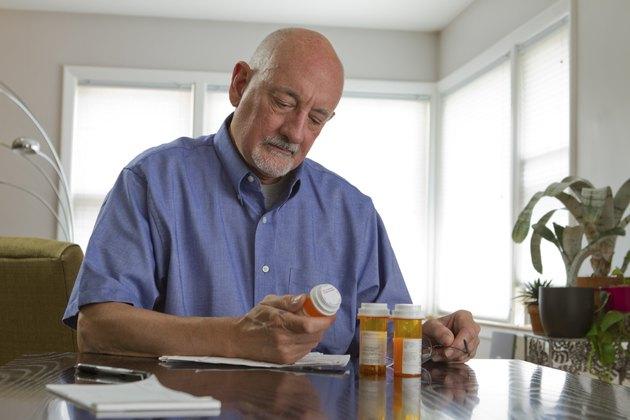 Older man with prescription medications