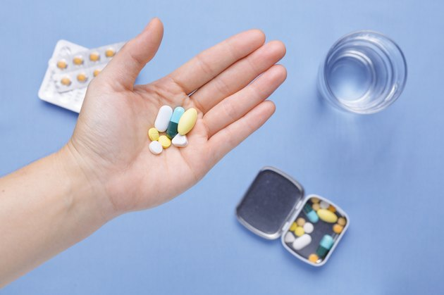 Pills and capsule on hand