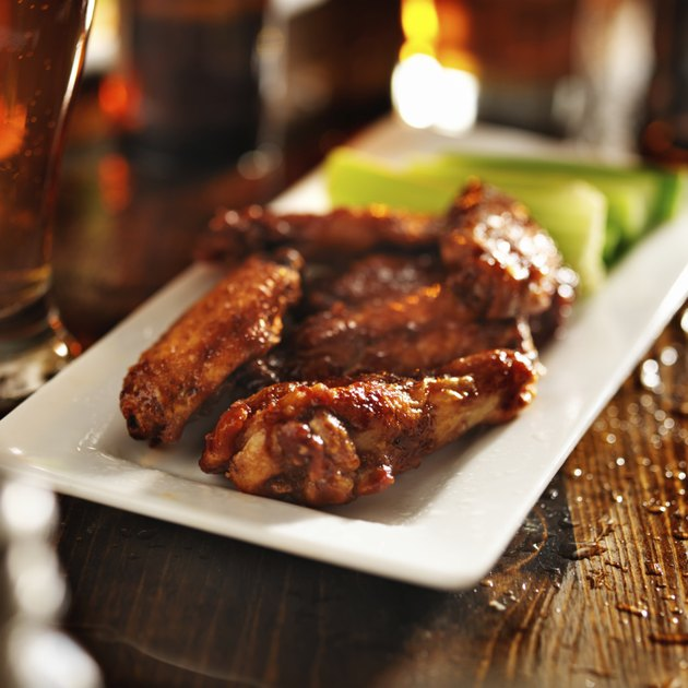 barbecue chicken wings with beer and celery
