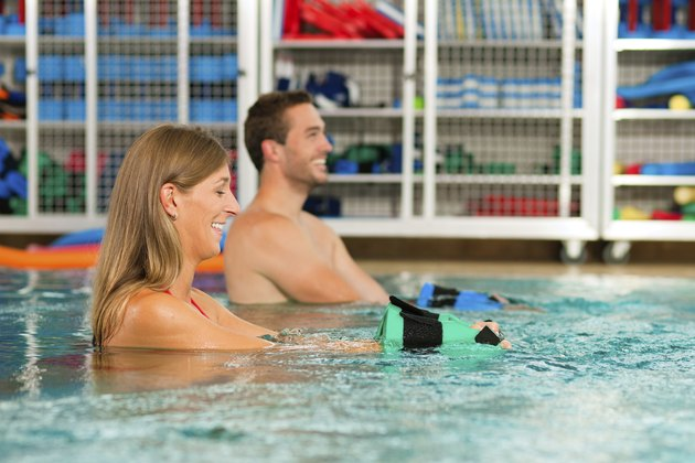 Couple exercising Aquarobics