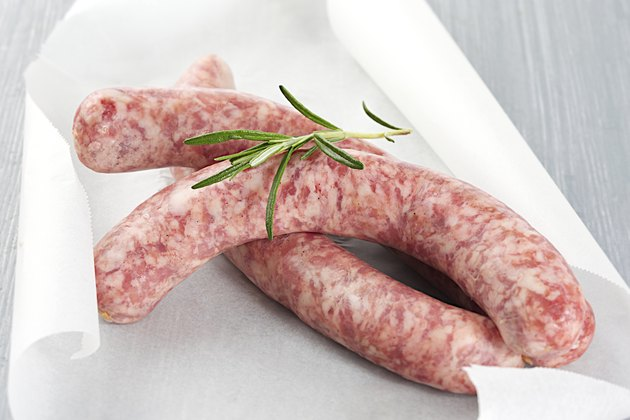 Raw sausages chipolata with herbs