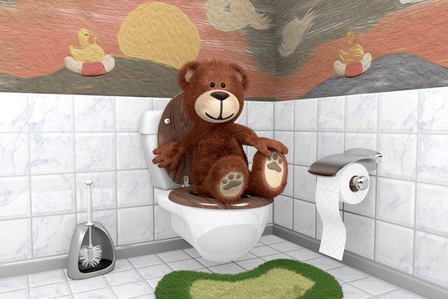 Teddybär auf Kloschüssel