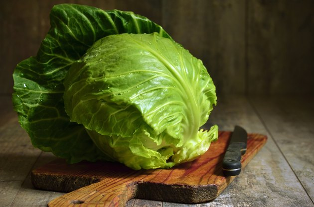 Cabbage head on cutting board.