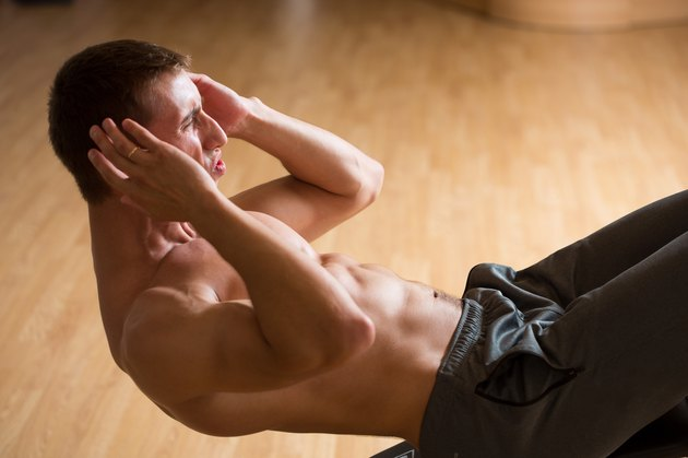 sport, lifestyle and people concept - man exercising in gym