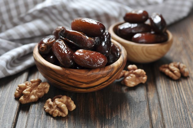 Dates fruit in a wooden bowl