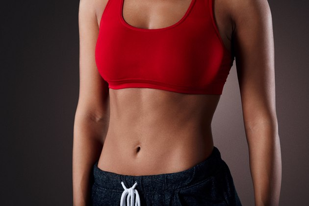 Beautiful mixed race sporty woman with slim stomach