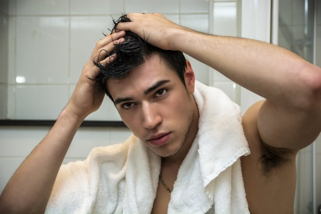 Gorgeous Man after Shower Holding his Head