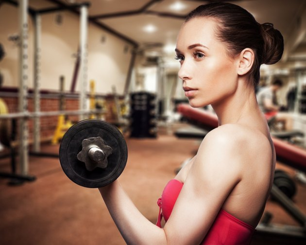 Portrait of pretty girl training in gym
