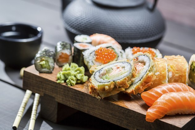 Closeup of fresh sushi on wooden board