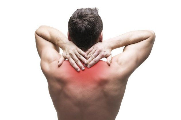 Pain in the neck. Man with backache. Muscular male body. Isolated on white background with red dot