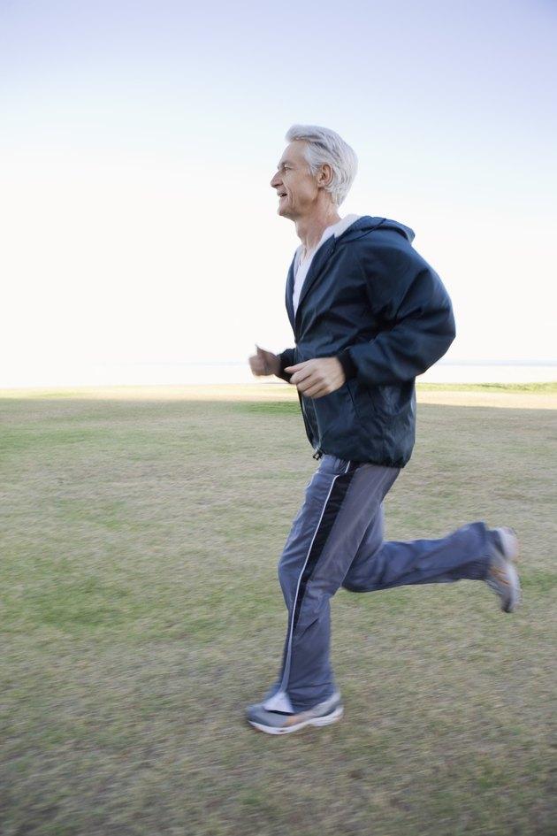Man jogging in field