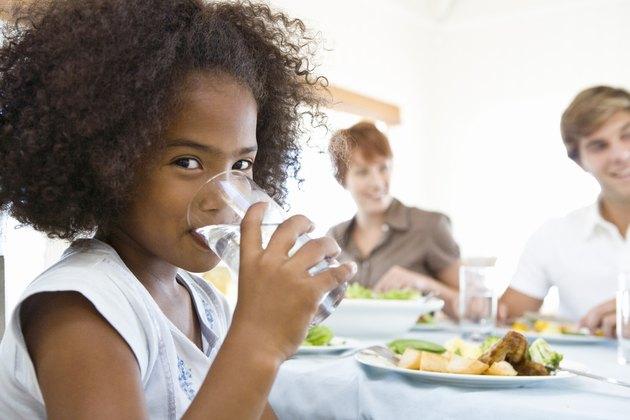 Girl drinking milk at dinner