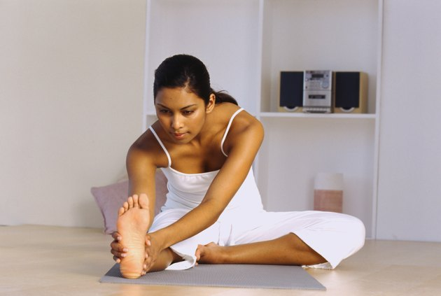 Low angle view of a young woman doing stretching exercises